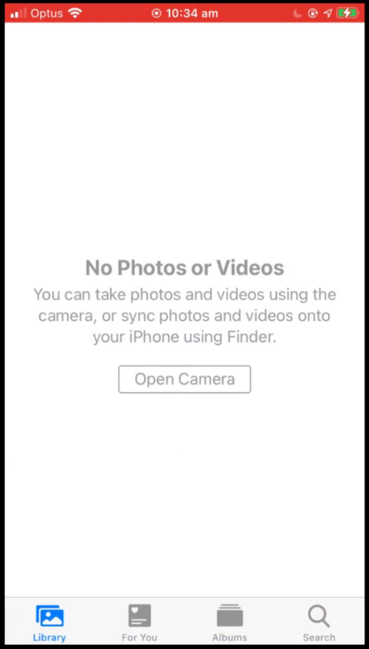 image displaying empty photos app on mobile phone